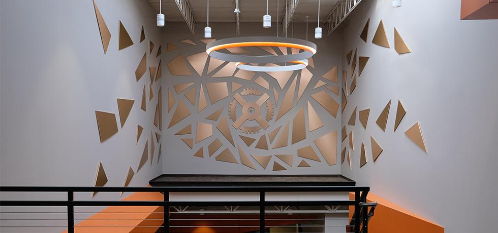 Generac Sculpture Installation | Decorative Metals in Brushed Penny