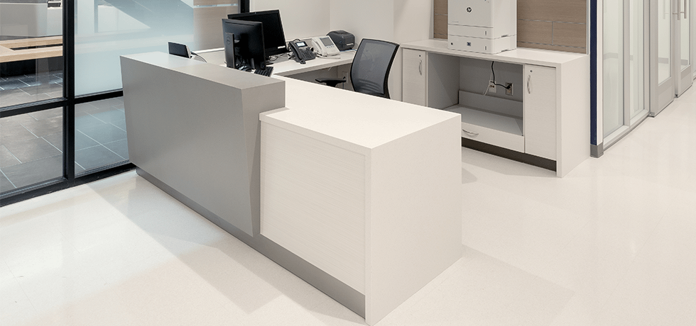 Welcome Desk | Solid Surface in Yukon Riverstone