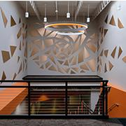 Generac Sculpture Installation | Decorative Metals in Brushed Penny